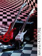 Купить «Гитары и звукоусилительная аппаратура в студии на шахматном фоне», фото № 4517702, снято 10 декабря 2011 г. (c) Losevsky Pavel / Фотобанк Лори
