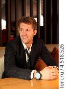 Купить «Молодой человек в черном костюме сидит за столиком в ресторане», фото № 4518526, снято 2 февраля 2012 г. (c) Losevsky Pavel / Фотобанк Лори