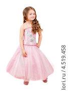 Купить «Красивая девочка позирует в розовом платье на белом фоне», фото № 4519458, снято 23 апреля 2012 г. (c) Сергей Сухоруков / Фотобанк Лори