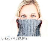 Купить «Девушка в свитере с воротником, натянутым до глаз», фото № 4529942, снято 8 мая 2010 г. (c) Wavebreak Media / Фотобанк Лори