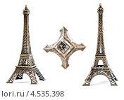 Купить «Эйфелева башня, статуэтка на белом фоне», фото № 4535398, снято 23 февраля 2019 г. (c) Валерия Потапова / Фотобанк Лори
