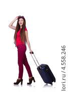 Купить «Молодая девушка с чемоданом отправляется в вояж», фото № 4558246, снято 14 марта 2013 г. (c) Elnur / Фотобанк Лори