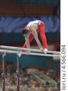 Купить «Lucas Fischer, Швейцария выполняет упражнения на брусьях на Чемпионате Европы по спортивной гимнастике», фото № 4566094, снято 21 апреля 2013 г. (c) Stockphoto / Фотобанк Лори