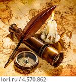 Купить «Компас, подзорная труба, перо и свеча на старой карте мира», фото № 4570862, снято 25 апреля 2013 г. (c) Андрей Армягов / Фотобанк Лори