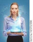 Купить «Привлекательная деловая женщина в офисной одежде с планшетным компьютером в руках», фото № 4573558, снято 17 ноября 2012 г. (c) Syda Productions / Фотобанк Лори