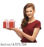 Купить «Юная девушка в красном платье с подарком в руках», фото № 4573794, снято 28 октября 2012 г. (c) Syda Productions / Фотобанк Лори