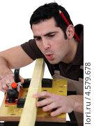 Купить «Столяр работает за верстаком», фото № 4579678, снято 28 февраля 2011 г. (c) Phovoir Images / Фотобанк Лори