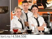 Купить «Улыбающиеся официанты в кафе», фото № 4584506, снято 9 февраля 2013 г. (c) CandyBox Images / Фотобанк Лори