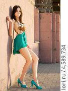 Купить «Девушка в сексуальном платье позирует возле стены», фото № 4589734, снято 27 апреля 2012 г. (c) Сергей Сухоруков / Фотобанк Лори