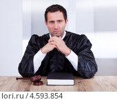Купить «Портрет судьи в мантии за столом», фото № 4593854, снято 14 июля 2012 г. (c) Андрей Попов / Фотобанк Лори