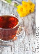 Купить «Чашка чая и одуванчики», фото № 4612430, снято 8 мая 2013 г. (c) Darkbird77 / Фотобанк Лори
