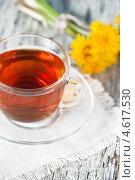 Купить «Чашка чая и одуванчики», фото № 4617530, снято 8 мая 2013 г. (c) Darkbird77 / Фотобанк Лори