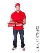 Купить «Разносчик пиццы с термосумкой в руках», фото № 4676202, снято 27 октября 2012 г. (c) Андрей Попов / Фотобанк Лори