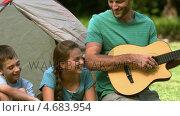 Купить «Father playing guitar for his family », видеоролик № 4683954, снято 16 февраля 2019 г. (c) Wavebreak Media / Фотобанк Лори