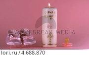 Купить «Baby shoes falling beside lit baptism candle and pacifier», видеоролик № 4688870, снято 31 мая 2020 г. (c) Wavebreak Media / Фотобанк Лори
