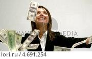 Купить «Money falling on businesswoman», видеоролик № 4691254, снято 16 февраля 2019 г. (c) Wavebreak Media / Фотобанк Лори