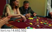 Купить «People placing bets at craps table», видеоролик № 4692502, снято 20 июня 2019 г. (c) Wavebreak Media / Фотобанк Лори