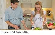 Купить «Woman tossing salad and man drinking wine», видеоролик № 4692886, снято 27 июня 2019 г. (c) Wavebreak Media / Фотобанк Лори