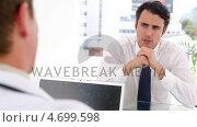 Купить «Black-haired man talking with a doctor», видеоролик № 4699598, снято 6 августа 2020 г. (c) Wavebreak Media / Фотобанк Лори