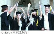 Купить «Happy graduates raising arms and jumping », видеоролик № 4702678, снято 5 апреля 2020 г. (c) Wavebreak Media / Фотобанк Лори
