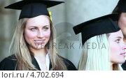Купить «Close-up pan right of graduates holding their diploma», видеоролик № 4702694, снято 5 апреля 2020 г. (c) Wavebreak Media / Фотобанк Лори