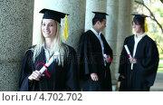 Купить «Portrait of a female graduate», видеоролик № 4702702, снято 5 апреля 2020 г. (c) Wavebreak Media / Фотобанк Лори