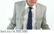 Купить «Sad businessman showing his empty pockets», видеоролик № 4705590, снято 18 июня 2019 г. (c) Wavebreak Media / Фотобанк Лори