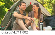 Купить «Cute couple drinking coffee outdoors», видеоролик № 4711002, снято 17 июля 2019 г. (c) Wavebreak Media / Фотобанк Лори