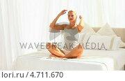 Купить «Good looking woman on her bed», видеоролик № 4711670, снято 26 марта 2019 г. (c) Wavebreak Media / Фотобанк Лори