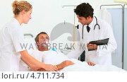 Doctors with an unconscious patient. Стоковое видео, агентство Wavebreak Media / Фотобанк Лори