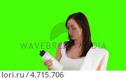 Купить «Dark-haired  woman after sport looking at the camera », видеоролик № 4715706, снято 6 августа 2020 г. (c) Wavebreak Media / Фотобанк Лори