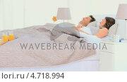Купить «Couple having breakfast in bed», видеоролик № 4718994, снято 23 июля 2019 г. (c) Wavebreak Media / Фотобанк Лори