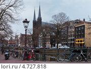 Купить «Амстердам. Готические шпили церкви Крийберг на канале Сингел (De Krijtberg Kerk)», фото № 4727818, снято 9 апреля 2013 г. (c) Виктория Катьянова / Фотобанк Лори