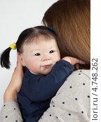 Реалистичная кукла азиатской внешности. Стоковое фото, фотограф Marina Appel / Фотобанк Лори