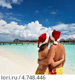 Пара отмечает Новый год на Мальдивах. Стоковое фото, фотограф Николай Охитин / Фотобанк Лори