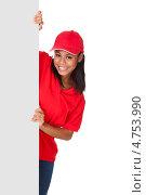 Купить «Девушка в униформе разносчика пиццы выглядывает из-за пустого плаката», фото № 4753990, снято 28 октября 2012 г. (c) Андрей Попов / Фотобанк Лори