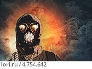 Купить «Пост-апокалипсис. Человек в противогазе на фоне ядерного взрыва», фото № 4754642, снято 5 марта 2013 г. (c) Sergey Nivens / Фотобанк Лори