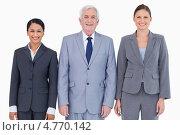Купить «Бизнесмены стоят и улыбаются», фото № 4770142, снято 8 ноября 2011 г. (c) Wavebreak Media / Фотобанк Лори