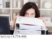 Купить «Грустная уставшая девушка на работе рядом с кучей папок с бумагами», фото № 4774446, снято 1 января 2013 г. (c) Андрей Попов / Фотобанк Лори