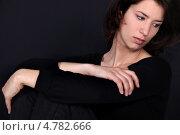 Задумчивая девушка на черном фоне. Стоковое фото, фотограф Phovoir Images / Фотобанк Лори