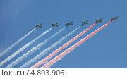 Купить «Триколор над Красной площадью. Фронтовые штурмовики С-25 рисуют российский флаг на параде 9 мая 2013 года в Москве», эксклюзивное фото № 4803906, снято 9 мая 2013 г. (c) Литвяк Игорь / Фотобанк Лори