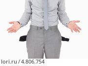 Купить «Разоренный бизнесмен с пустыми карманами», фото № 4806754, снято 22 сентября 2011 г. (c) Wavebreak Media / Фотобанк Лори