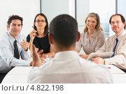Купить «Руководитель разговаривает с сотрудниками за столом. Вид со спины», фото № 4822198, снято 26 октября 2012 г. (c) Monkey Business Images / Фотобанк Лори