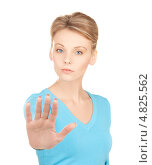 Купить «Девушка показывает рукой жест стоп», фото № 4825562, снято 12 декабря 2009 г. (c) Syda Productions / Фотобанк Лори