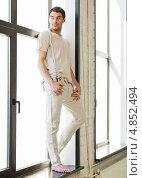 Купить «Привлекательный молодой мужчина у большого окна», фото № 4852494, снято 8 апреля 2012 г. (c) Syda Productions / Фотобанк Лори