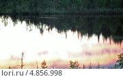 Купить «Лесное озеро с отражением закатного неба, Карелия», видеоролик № 4856998, снято 16 июля 2013 г. (c) Кекяляйнен Андрей / Фотобанк Лори