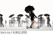 Купить «Очаровательная бизнес-леди на самокате с черным зонтиком в толпе людей», фото № 4862650, снято 23 апреля 2019 г. (c) Sergey Nivens / Фотобанк Лори