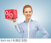 Купить «Привлекательная девушка в голубой блузке со знаком процентов на коробке», фото № 4862926, снято 10 апреля 2012 г. (c) Syda Productions / Фотобанк Лори