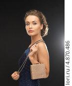Купить «Девушка в вечернем платье с сумочкой и картой вип гостя», фото № 4870486, снято 17 марта 2013 г. (c) Syda Productions / Фотобанк Лори