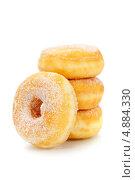 Купить «Пончики, изолированно на белом фоне», фото № 4884330, снято 24 мая 2013 г. (c) Наталия Кленова / Фотобанк Лори